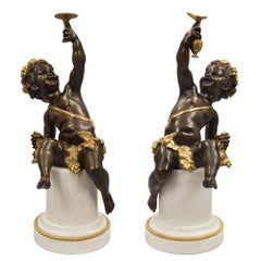 True Pair of French 19th Century Louis XVI Style Bronze Statues of Cherubs