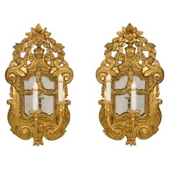 Pair of Italian 18th Century Louis XV Period Two-Arm Giltwood Mirrored Sconces