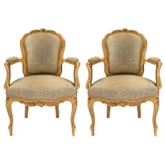 Pair of French Louis XV Style Mid-19th Century Giltwood Armchairs