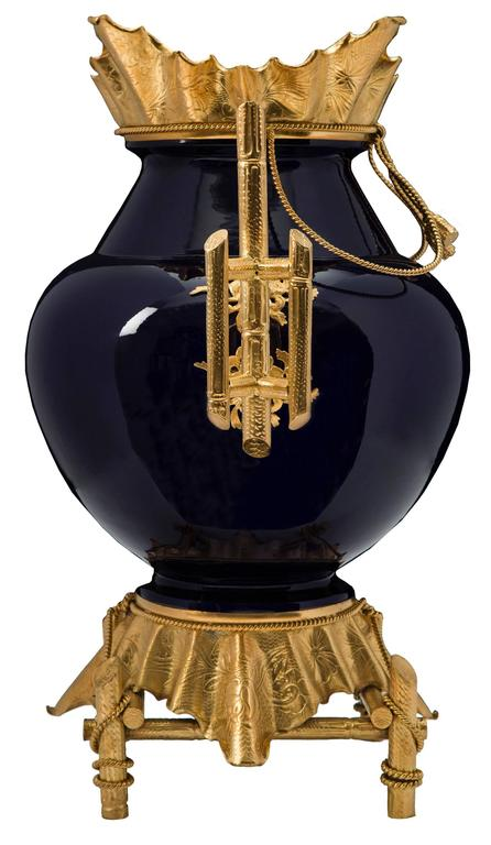 A sensational and extremely large-scale, French, 19th century, Louis XVI style cobalt blue porcelain and ormolu vase, signed Sarreguemines. The vase is raised by a wonderful ormolu base with four post like supports with finely executed swaging