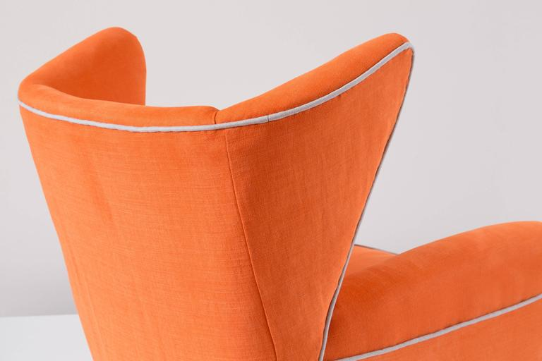 Mid-20th Century Pair of Large Attributed Melchiorre Bega Wingback Orange Armchairs, 1952 For Sale