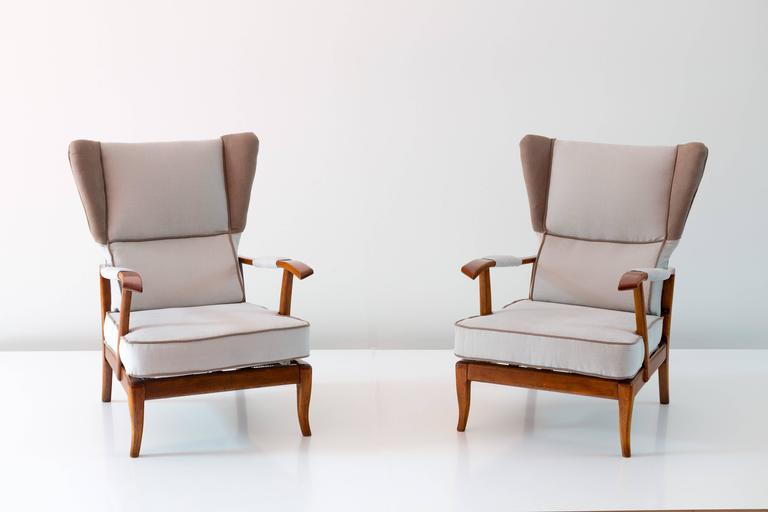 Interesting pair of reclining wingback armchairs by paolo for Interesting armchairs