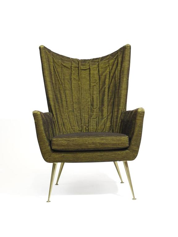 1950s Italian channel-back lounge chairs in original olive green horsehair textile, hand-sewn draped upholstery on backs and arms. Conically tapered brass legs. Matching high-back settee available upon request.