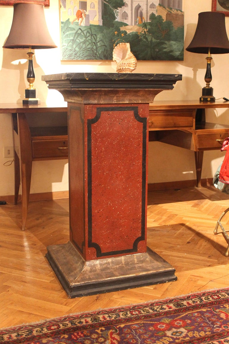This pair of gorgeous columns or pedestals have a large squared top and base section and are very professionally painted as faux marble with nice silvered details. The central part is red painted as faux Porphyry marble and each part of the column