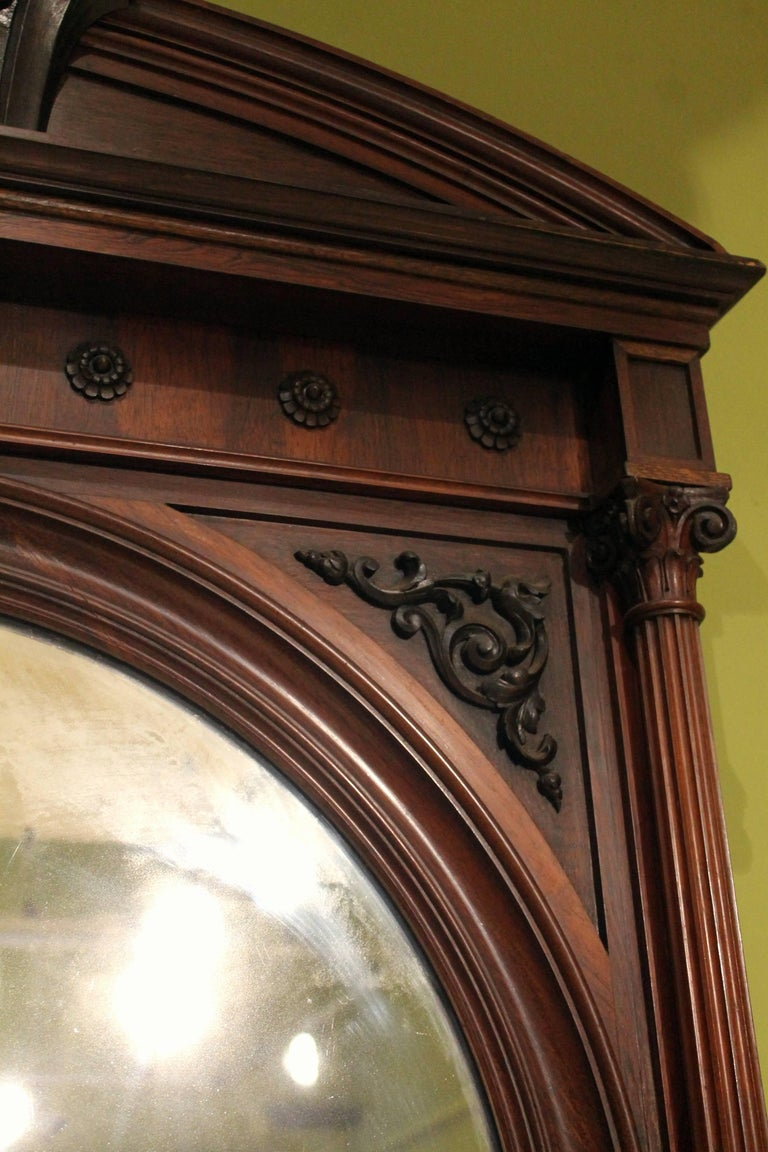 This wonderful 19th Century antique English 3 meters tall full-length mirror in dark brown rosewood is ornamentally shaped with architectural features as a Greek temple. This Greek revival style arched floor mirror has all the features commonly
