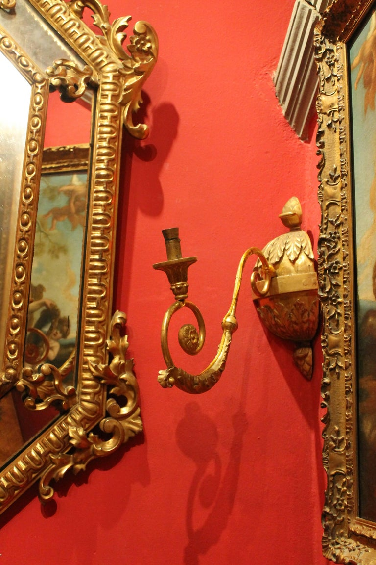 18th Century and Earlier Pair of Italian Baroque Hand-Carved Giltwood Sconces with Gilt Bronze Arm For Sale