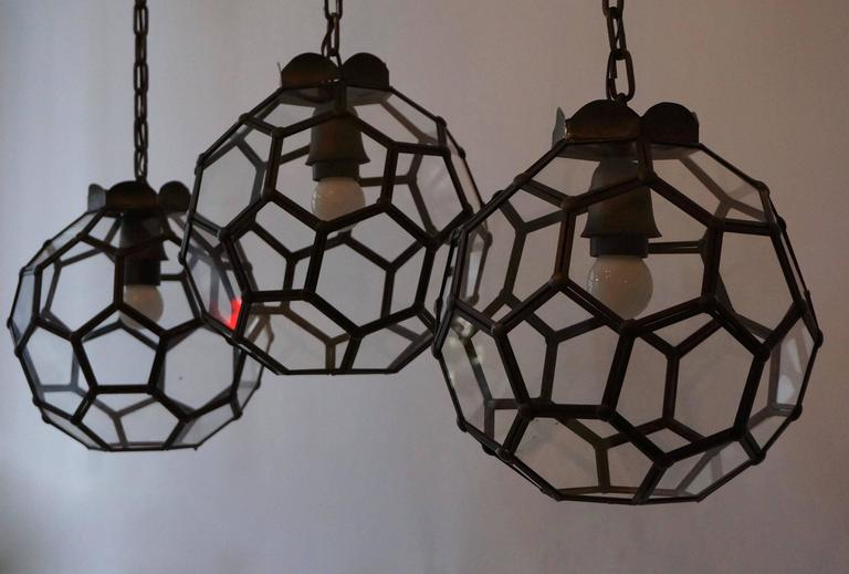 Set of three Italian stained glass pendant lights.