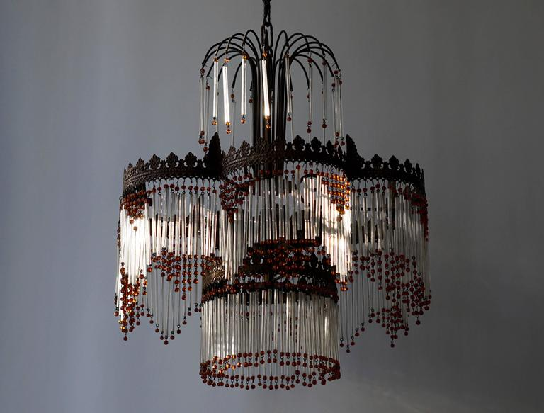Italian Murano chandelier. Diameter:50 cm. Height fixture:50 cm. Total height with the chain is 95 cm. Six E14 bulbs.