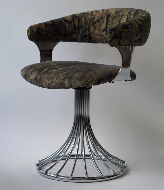Set off six vintage chrome swivel chairs.