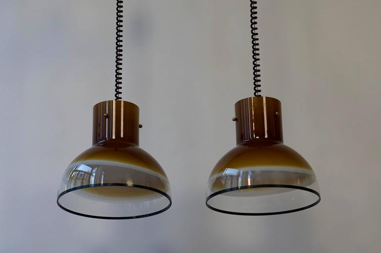 A set of eight gorgeous Italian Murano ceiling lights from the seventies. The height can be adjusted from 29.52 inches to 51.18 inches, the diameter of the glass is 13,77 inches.