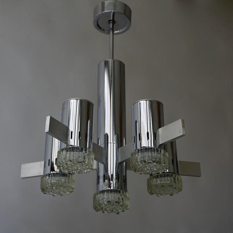 Sciolaro glass and chroom chandelier. Height: 66 cm. Diameter: 50 cm. Six E14 bulbs.