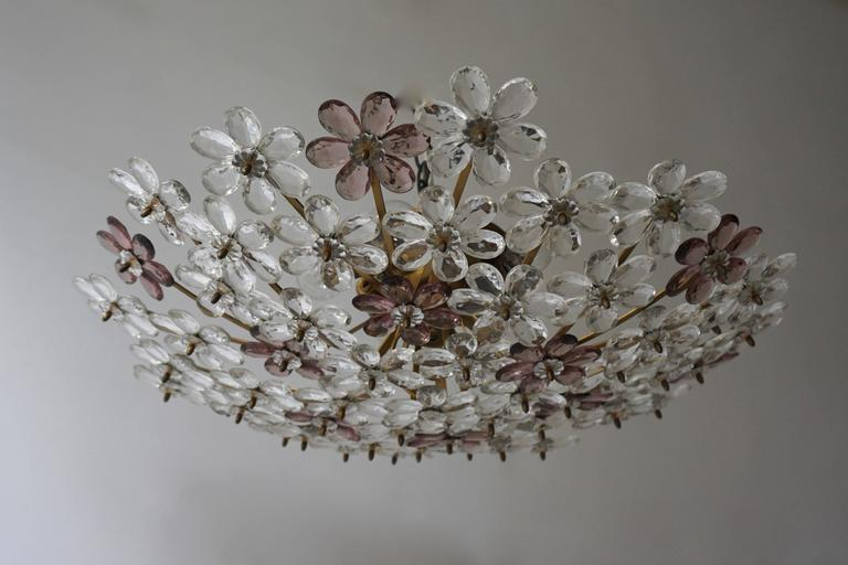A pair of two Italian glass and brass flush mounts or wall lights with 60 glass flowers.