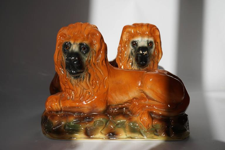 Set of two ceramic lions.