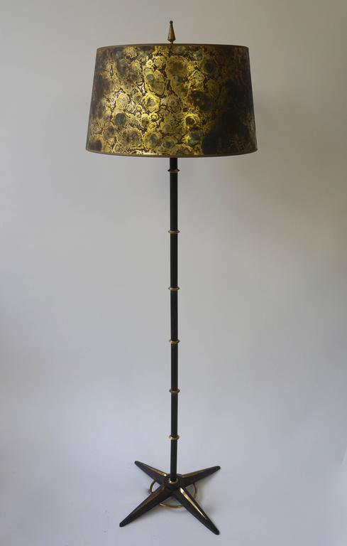 Beautiful 1950s black metal and brass floor lamp with gold colored shade.