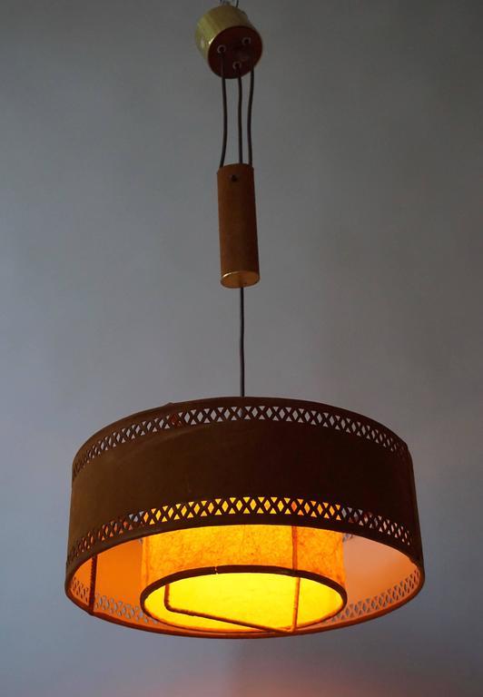 Adjustable ceiling fixture in brass, suede and parchment. Diameter 45 cm. Minimum height 90 cm. Maximum height 120 cm.