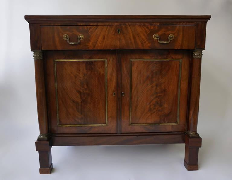 Empire mahogany veneer on oak sideboard with columns.