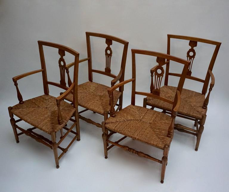 Set of Four Wicker Arm Chairs 2