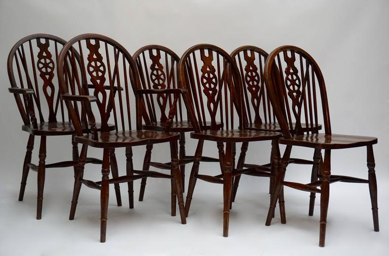 Six unusual and wonderful aged, worn patina chairs are in good condition.They look fantastic together as a set. The seat height of all seats is 18.5 in. (47 cm) The height of the armrest is 26.77 in. (68 cm) The two high back chairs are 37.79 in.