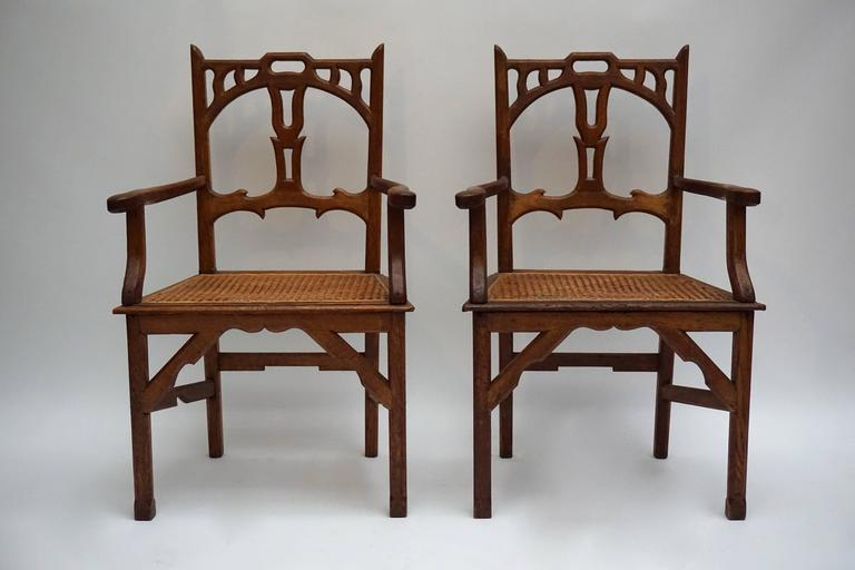 Belgian Two Italian Art Nouveau Carved Teak Armchairs For Sale