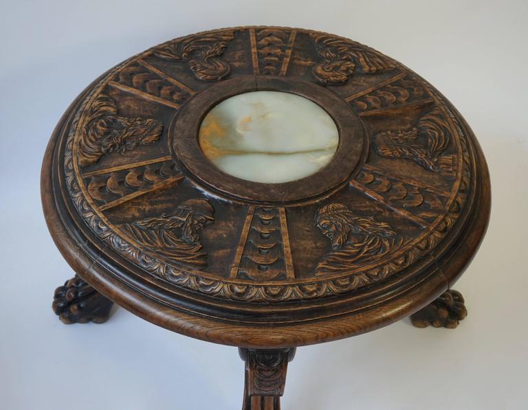 Deep relief carved Belgium low table. Measures: Diameter 80 cm, height 50 cm.