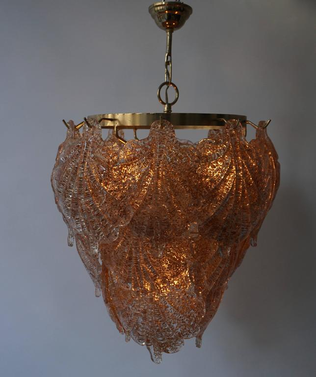 Three Murano chandeliers with each 20 glass leaves. Diameter 42 cm. Height fixture 45 cm. Total height with the chain is 64 cm. Four E27 bulbs inside.