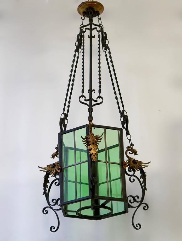 Awesome French lantern decorated with brass dragons.