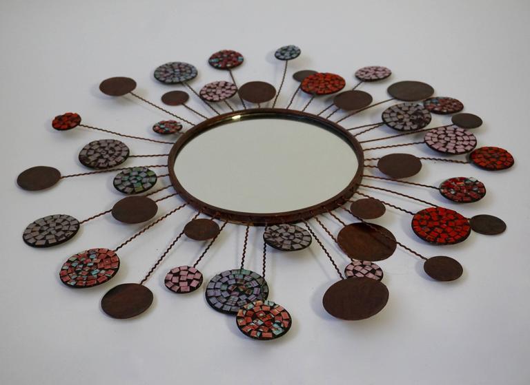 Ceramic mirror. Measures: Diameter 65 cm.