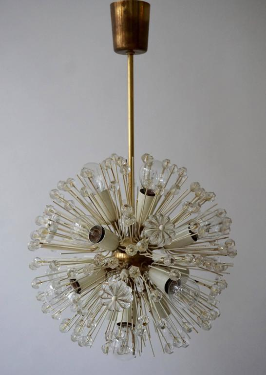 Sputnik thirteen-light brass fixture with copious amounts of Austrian crystals by Emil Stejnar for Nikoll. Cosmological. This glamorous delicate brass 'Snowball' Sputnik chandelier is also known as 'pusteblume', or 'snowflake' and is made in Vienna