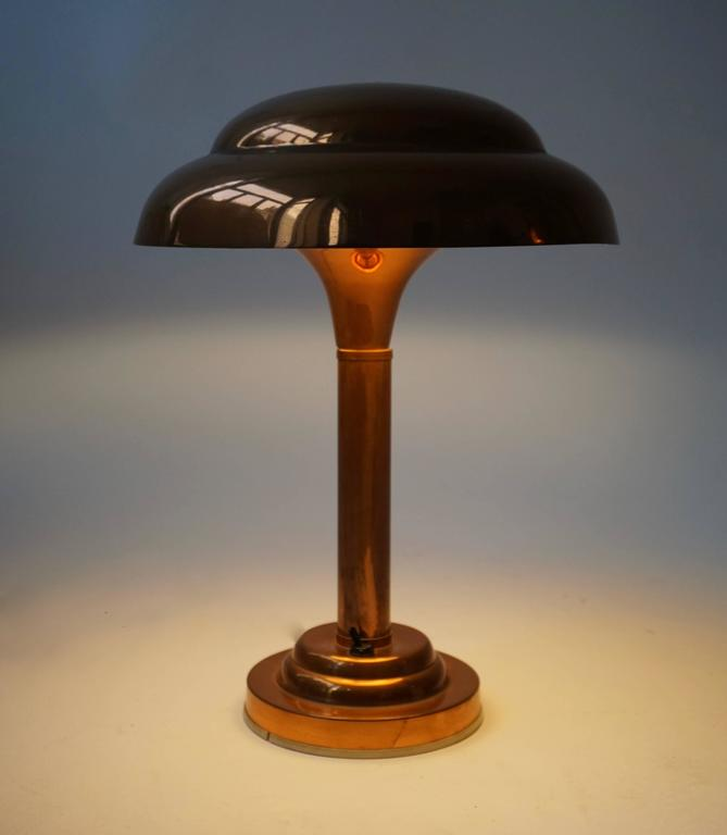 Art Deco copper table lamp. Measures: Diameter 29 cm. Height 39 cm.