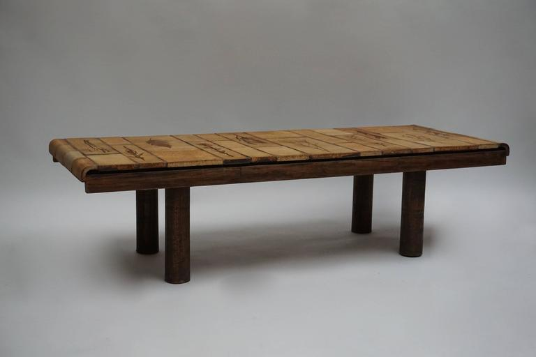 An architectural wood and ceramic table by Roger Capron, France. Measures: Height 38 cm. Width 142 cm. Depth 54 cm. Weight 44 kg.