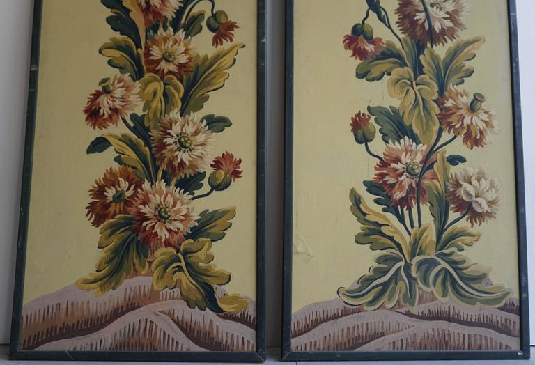 Two framed wall panels with flower decorations. Height: 155 cm Width: 58 cm. Price per item.