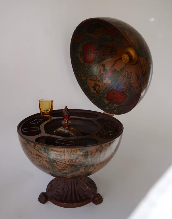 Very elegant Italian Mid-Century Modern globe dry bar. The globe opens to reveal a dry bar inside with plenty of space. Having pictures of Greek mythology and mythical creatures. Adding the perfect decor to any room. Measures: Height 55