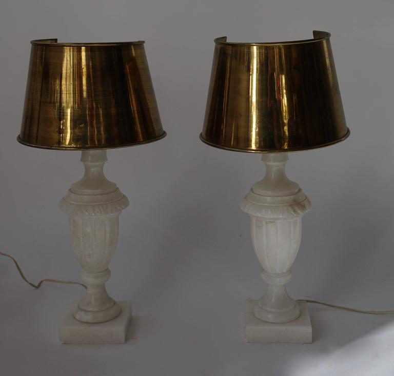 Two alabaster with copper shades table lamps. Measures: Diameter 20 cm. Height 52 cm.