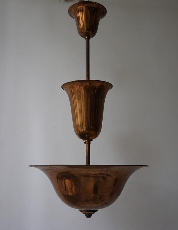 Art Deco copper chandelier. Measures: Diameter 45 cm. Height 85 cm.