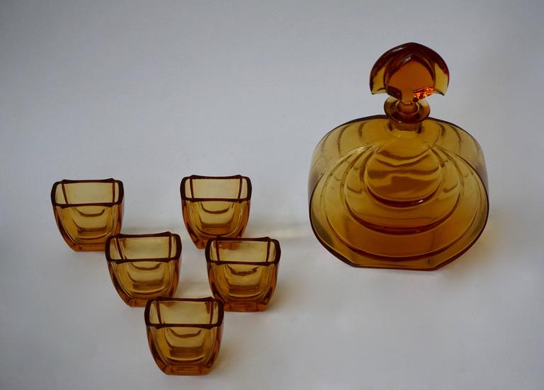 Amber color Murano set of carafe and five glasses.