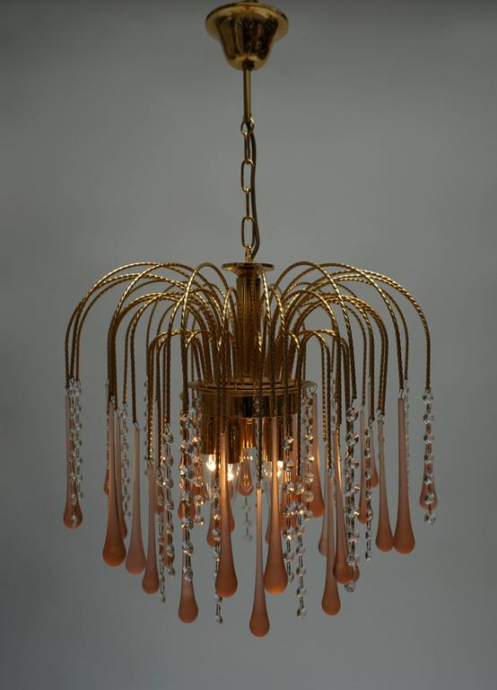 Italian brass and Murano glass teardrop chandelier. Measure: Diameter 50 cm. Height fixture 45 cm. Total height with the chain 75 cm.