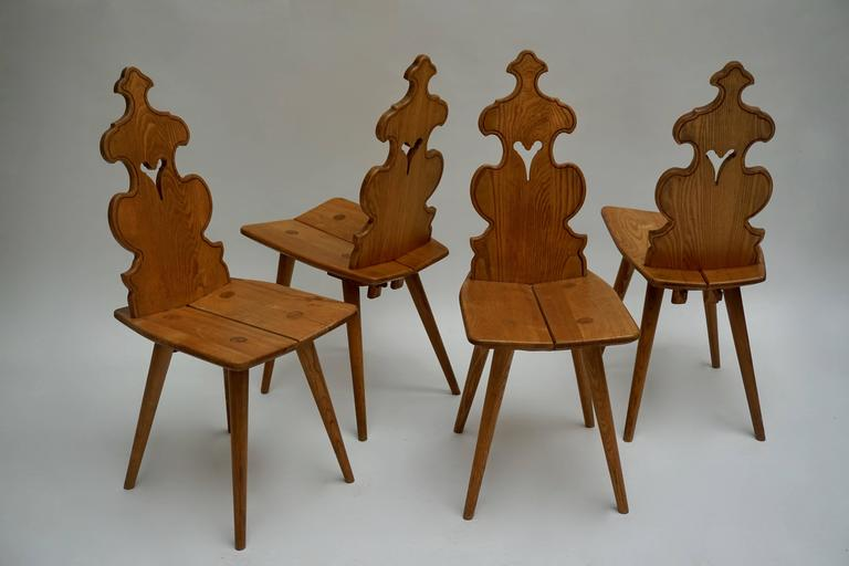 Four wooden chairs, Poland. Measures: Height 92 cm.