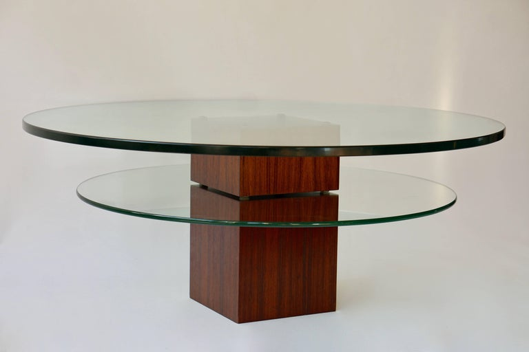 Glass coffee table with wooden base. Diameter:100 cm. Height:40 cm.