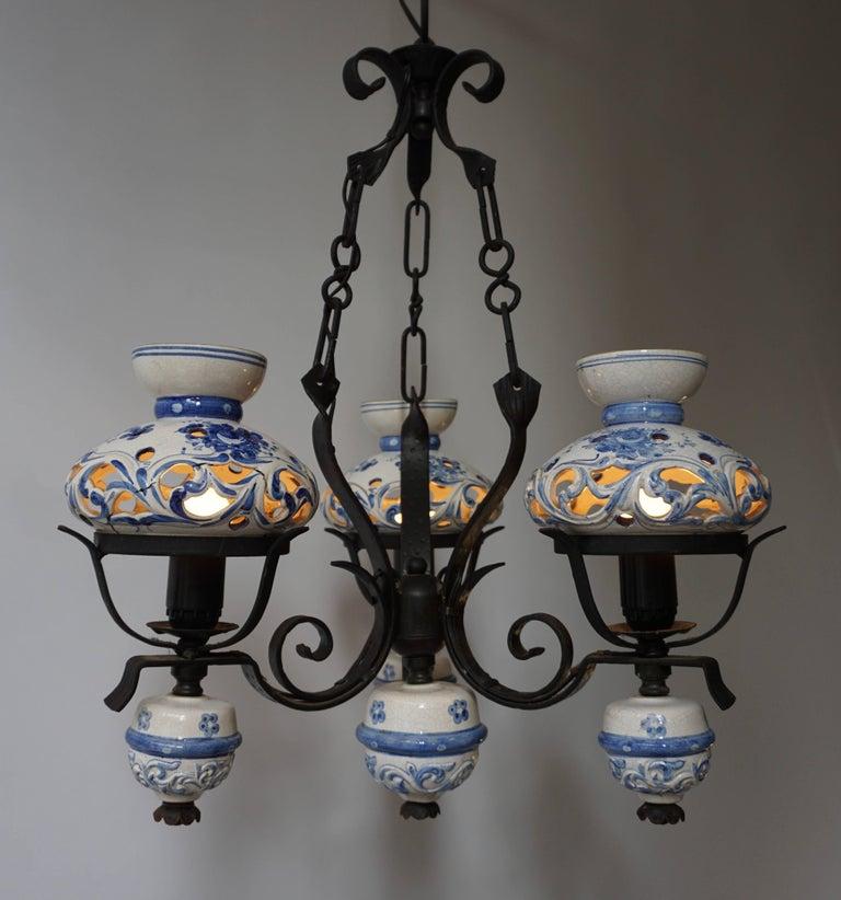 Unique and beautiful antique delft blue oil lamp chandelier converted to electricity. Measures: Diameter 50 cm. Height fixture 70 cm.