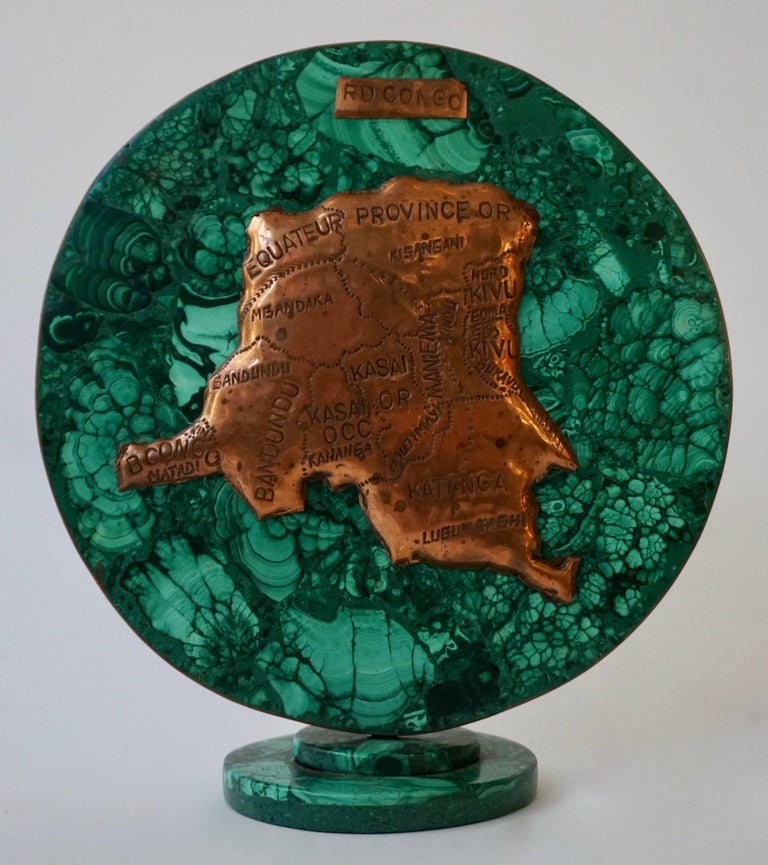 Malachite sculpture with the map of Congo. Diameter:19 cm. Height:21 cm. Depth:8 cm.