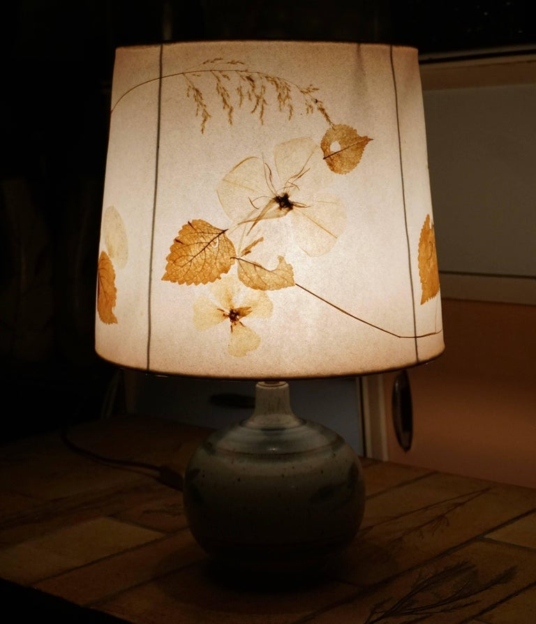 Table lamp with nature leaves lampshade.