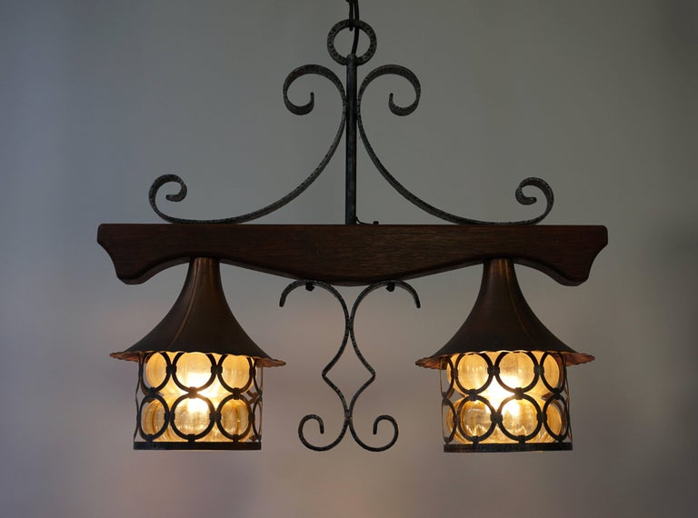 Copper and wooden pendant light. Measures: Width 60 cm. Depth 20 cm. Height fixture 54 cm. Total height with the chain 120 cm. Two E27 bulbs.