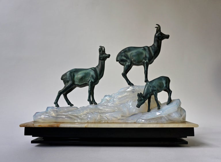 An Art Deco sculpture with three deer on a marble base. Measures: Width:43 cm. Depth:15 cm. Height:37 cm. Weight:10 kg.