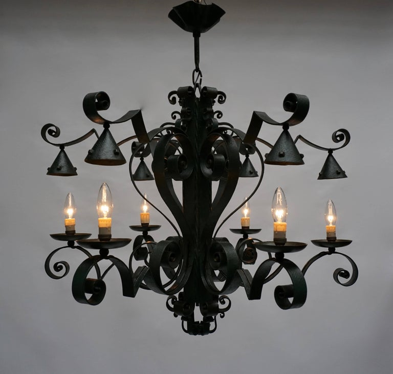 A large French six-light wrought iron chandelier. Beautifully crafted iron work and nice old patina.