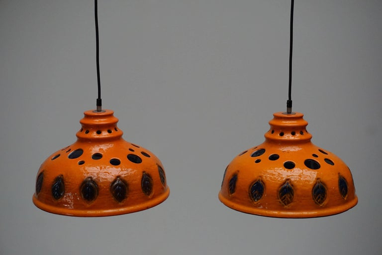 Two ceramic pendant lights. Measures: Diameter 35 cm. Height fixture 22 cm. Total height 130 cm. The weight per lamp is 1 kg. Price is per item.