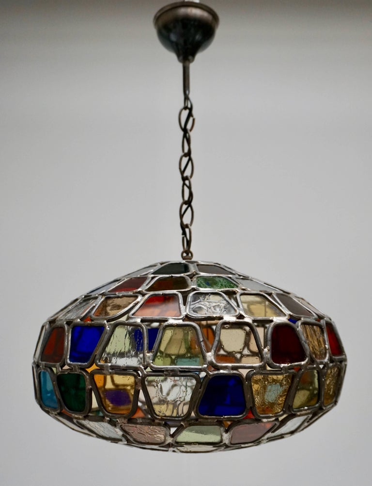 Colorful stained glass pendant with iron chain. Diameter:40 cm. Height fixture:20 cm. Total height: 55 cm. One E27 bulb.