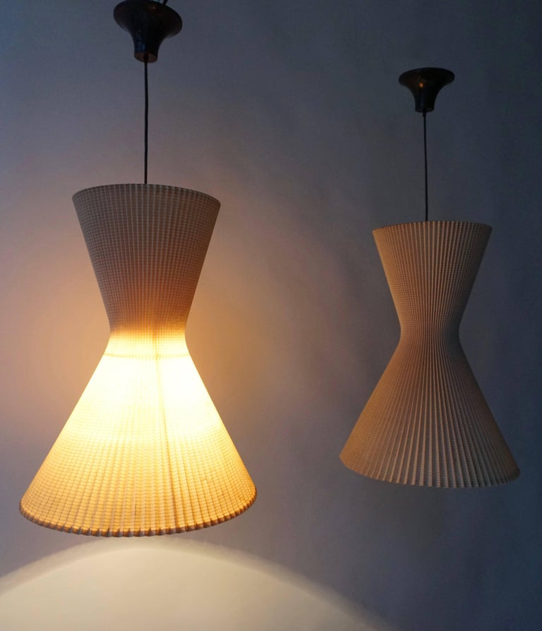 Two Italian pendant lights. Measures: Diameter 37 cm. Height fixture 45 cm. Total height 90 cm.