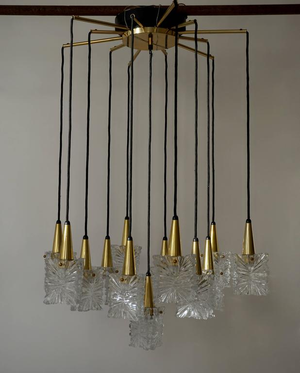 Glass and brass chandelier by RAAK, Netherlands.