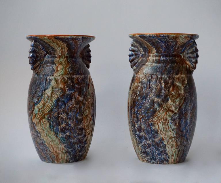 A pair of Belgian ceramic vases. Measures: Diameter 14 cm, height 25 cm.