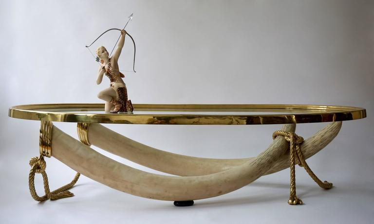 "Large and heavy cast resin tusks with solid brass ""rope"" details. 